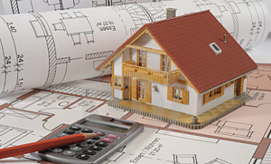 House sitting on floor plans with a calculator – 5 trends in new homes - Richardson Custom Homes - Fort Myers – jpg300x181