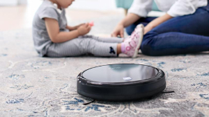 Robot vacuum working on floor with baby – 5 trends in new homes - Richardson Custom Homes - Fort Myers – jpg300x169
